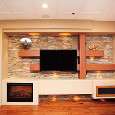 Contemporary Family Room by Heritage Construction Specialists