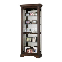 Howard Miller - Ricardo Sliding Door Curio Cabinet in Hampton - The details on this classic, cherry-finished curio cabinet add to its character and charm. Large reeded columns feature rosette-style carvings. Display cherished items on five glass shelves that are adjustable. Mirrored back panel helps show off your collection. Large reeded columns feature decorative top corner overlays. Dark antique brass knob and back plate adds stylish accent to front of door. Front door slides in both directions for convenient access to the shelves. Halogen lighting for brighter, whiter, longer-lasting light to illuminate your collectibles. Adjustable levelers under each corner provide stability on uneven and carpeted floors. Locking door for added security. Cabinet is illuminated by an interior light. Glass shelves can be adjusted to any level within your cabinet. Glass mirrored back beautifully showcases your collectibles. No-Reach light switch is conveniently located on the back of the cabinet. Pad-Lock cushioned metal shelf clips increase stability and safety. Lightly distressed finish in Hampton Cherry. Made of Hardwoods and Veneers. 32 in. W x 14 1/4 in. D x 78 in. H