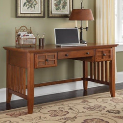 """Home Styles - Arts and Crafts Executive Writing Desk - Mission styling at its best! The Arts & Crafts Executive Writing Desk embellishes typical mission styling with framed doors showcasing raised wood, lattice moldings and slightly flared legs. The drop-front center drawer can also be used as a keyboard tray with two additional storage drawers on each side. Construction is of hardwood solids and veneers in a warm, multi-step finish with finished hardware. Features: -Mission styling.-Drop front center drawer.-Storage drawers.-Lattice moldings and slightly flared legs.-Center drawer can be used as a keyboard tray.-Hardwood solids and veneer construction.-Desk Type: Executive desk.-Powder Coated Finish: No.-Gloss Finish: No.-UV Finish: No.-Top Material: Wood.-Base Material: Wood.-Number of Items Included: 1.-Pieces Included: Desk.-Distressed: No.-Collection: Arts and Crafts.-Keyboard Tray: Yes.-Drawers Included: Yes.-Chair Included: No.-Commercial Use: No.-Product Care: Clean with damp cloth.-Swatch Available: No.-Recycled Content: No.Specifications: -FSC Certified: No.-CARB Compliant: Yes.-ISTA 3A Certified: Yes.Dimensions: -Overall Height - Top to Bottom: 30"""".-Overall Width - Side to Side: 54"""".-Overall Depth - Front to Back: 28"""".-Cabinet: No.-Drawer: -Drawer Interior Height - Top to Bottom: 3""""..-Overall Product Weight: 116 lbs.Assembly: -Assembly required.-Assembly Required: Yes."""