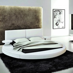 Modern Furniture At Deeply Discounted Prices - The 383B modern round leather bed is a mega modern design affording your bedroom to have a restful ambiance. Offering functionality is the round platform that features two pieces of round nightstands on each side of the bed supported by steel legs. It likewise offers more space to put some paraphernalia. The wide expanse of the tufted headboard gives you adequate back support. Upholstered in full PVC material, it can be upgraded to genuine leather quality through our sales staff.
