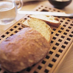 "Skagerak - Teak Pantry Bread Tray - The kitchen is the home's workplace. This is where the same utensils and appliances are used day in and day out. As a result, they should be able to endure the wide-ranging effects of daily use without losing their function or appearance. Skagerak Denmark's many items for the kitchen range from beautiful, classic design in wood to innovative products made from new materials such as glass and stainless steel, expressing new styles and uses. The products all have on thing in common: they last - in terms of both form and function. True culinary art requires a feeling for detail and sensitivity to the whole; because unforgettable taste, sensations and special moments are crafted using fresh ingredients prepared with love and served with feeling. Additional Information: -Made of teak -Brings style and class to your kitchen utensils -Dimensions: 10""W x 17""L x 1.3""H About Skagerak Denmark and Teak Teak grows in South-East Asia. The planks are dark with a golden or greenish hue, often with appreciable iridescence. In some planks the grain can appear almost black. Teak is heavy, hard and stable. With its high content of naturally impregnating oils, teak is extremely resistant to wet and dry rot. Teak is used for our Hardwood Plank, Ships Plank, 3-Layer Plank, Teak Marine and Decking Plank. Skagerak Denmark Denmark A/S is a 100% Danish owned company founded in 1976 with headquarters in Hadsund. The primary business activities are design, development and sales of wooden furniture, flooring, gift articles and wood care products. Today more than 120 employees provide a turnover of more than DKK 300 mio., of which a continuously greater part comes from exports. Skagerak Denmarks mission Skagerak Denmark develops, markets and sells quality products - mainly of wood and other natural material - for use in private homes - outdoor as well as indoor. Their products primarily appeal to to consumers who value high quality, design and originality when they buy durable consumer goods. Skagerak Denmark aims to be an environment-orientated company that pays a great deal of attention to the environment, both internally in the company and in the progress of our products."