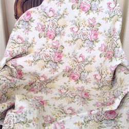 None - Pretty Peony Quilted Throw - Bring the outdoors into your bedroom with this pretty peony quilted throw. This throw showcases an intricate quilting that provides a rich surface texture.
