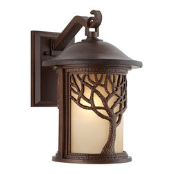 "John Timberland - Arts and Crafts - Mission Bronze Mission Style Tree 15"" High Outdoor Wall Light - This bronze Mission style outdoor lantern wall light has a stately tree design inspired by nature. A rounded cream diffuser offers warm light and rests behind the organic design. A wonderful way to brighten your exteriors while keeping the natural outdoors in mind. Bronze finish. Etched amber glass. Takes one 100 watt maximum type A bulb (not included). 15"" high. 10"" wide. Glass is 8 3/4"" high 6 1/4"" deep. Extends 12"" from wall. Backplate is 8"" high 5 1/2"" wide.  Bronze finish.  Etched amber glass.  Takes one 100 watt maximum type A bulb (not included).  15"" high.  10"" wide.  Glass is 8 3/4"" high 6 1/4"" deep.  Extends 12"" from wall.  Backplate is 8"" high 5 1/2"" wide."