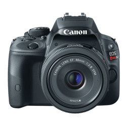 "Canon - EOS Rebel SL1 Digital SLR Camera Kit - 18.0 megapixel CMOS . 3"" color touchscreen LCD . ISO 100 - 12800 for stills . ISO 100 - 6400 for video . Up to 4.0 fps . EOS full HD video . Compatible with EF lenses . Compatible with SD Cards, SDHC Cards & SDXC Cards, Ultra High Speed (UHS-I) cards & Eye-Fi cards . Compatible with optional AC adapter kit ACK-E15 . Includes eyecup EF, battery pack, battery charger, wide strap, USB interface cable, EOS digital solution disc & software instruction manual CD & camera instruction manual . Dim: 3.57""H x 4.60""W x 2.74""D. Body onlyThe new EOS Rebel SL1 is small in size but enormous in performance. With a newly designed Canon 18.0 megapixel CMOS (APS-C) sensor and speedy Canon DIGIC 5 image processor, it is ideal for those stepping up from a smartphone or compact camera. An impressive ISO range of 100-12800 (expandable to H: 25600) for stills and 100-6400 (expandable to H: 12800) for video plus up to 4.0fps continuous shooting make this camera the go-to for any photo opportunity, even in dim lighting or when capturing fast action subjects."