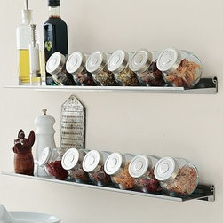 Gallery Ledge, 4 x 24', Stainless Steel & Spice Jars, Set of 6, one of each - Maximize your kitchen and office workspace with the versatile beauty - and durability - of stainless-steel accessories. Backsplash includes 5 clothespin magnets; multiples can be installed to line the entire kitchen. Magnetic canisters for storing spices attach to the backsplash. Post recipes, postcards or photos on the square and long rectangular boards. Alphabet magnets include all 26 letters. Ultra-thin gallery ledge can be used as a spice rack by adding our set of 6 flat-sided glass jars with airtight lids (sold separately). Mounting hardware included. Catalog / Internet Only.