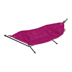 Fatboy - Headdemock in Pink - Includes a freestanding frame for indoor or outdoor use. Non woven mesh allows cooling airflow. Durable polyester cover. Protective coating for stain and water resistance. Easy to clean with damp cloth and mild soap. 110 in. L x 55 in. W x 12 in. H (54 lbs.)Forget about fancy spas, incense sticks or easy listening muzak. You havent felt truly relaxed until youve hung out with me. My smooth fabric and sturdy support frame guarantees that nothing besides a torrential downpour will disturb us. Take one swing on me and youll feel like youre sipping a coconut on a sunny beach in Hawaii listening to the ukulele.