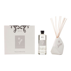 Joya - Quince & Heliotrope Petals Diffuser Set - Blood orange, mango, frangipani, tuscan iris powder and teakwood combine to create a fragrance unlike any other. Holding these exquisite scents together is an asymmetrical ceramic vase, designed in partnership with artist Sarah Cihat and featuring a dandelion motif.