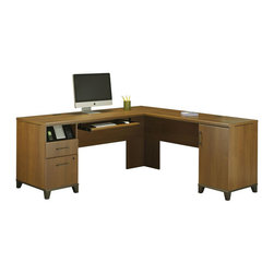 Bush - L-shaped Computer Desk - Desk has durable, expansive work surface. Integrated wire management grommet. Four port USB hub. Left pedestal contains charging station for personal electronic devices. Box drawer for miscellaneous supplies. Lockable file drawer that accommodates letter-size files. The right pedestal contains a large closed storage compartment with one adjustable shelf. Convenient pull-out tray great for keyboards or laptops. Fully furnished back side enables unit to be floated in the middle of a room. Pull hardware in oil rubbed bronze color. Optional Hutch offers vertical storage. Five open storage cubbies great for storing papers and folders. Two closed storage cabinets. Flip-up doors. Cabinets with lid-stay hinges and decorative frosted glass inserts. Two open center storage areas have one adjustable shelf each. Convenient wire management pass-through at bottom of unit. Wipe clean care. Contemporary style. Made from particleboard and laminates. Warm oak finish. Desk: 70.16 in. W x 70.31 in. D x 29.49 in. H. Optional Hutch: 69.92 in. W x 12.53 in. D x 39.49 in. H (118 lbs.)Achieve is office collection with fully integrated modern amenities and plenty of vertical and horizontal storage. It works equally well in a home office or small business environment.