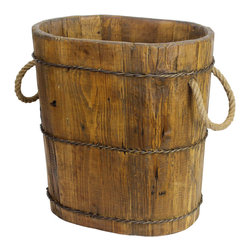Antique Revival - Natural Altai Tapered Wooden Bucket - The vintage Altai wooden bucket is a perfect for any country, rustic room. The thin iron bands around the middle keep the bucket secure, and the hemp rope handles add a rugged touch. It looks great as an accent piece on its own, or you can add flowers or an umbrella to keep things interesting. Great home decor piece that will be in your home to stay!