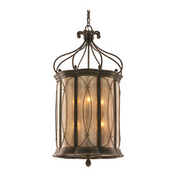 St. Moritz 8-Light Pendant - With a nod to the chic resort town in the Swiss Alps, the St. Moritz collection conveys majestic, refined style. This pendant boasts a hand-wrought, iron frame with a Moritz bronze finish, a tea-stain glass shade, and intricate design details. The larger of these pendants are ideal on their own over a dining table or in a foyer, while the smaller sizes can be grouped together over an island or counter in the kitchen.