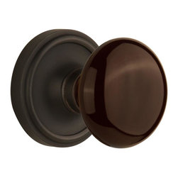 Nostalgic - Nostalgic Privacy-Classic Rose-Brown Porcelain Knob-Oil-Rubbed Bronze - The simple elegance of the Classic Rosette in oil rubbed bronze offers beauty and durability that will compliment a variety of architectural styles. Adding our rich, Brown Porcelain knob only serves to compliment the warm, earthen hues in your home. All Nostalgic Warehouse knobs are mounted on a solid (not plated) forged brass base for durability and beauty.