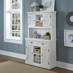 Home Styles - Home Styles Nantucket Distressed White China Cabinet - 5022-617 - Shop for Buffets and Side Boards from Hayneedle.com! A country charmer the Home Styles Nantucket Distressed White Dining Buffet has bead board detailing a perfectly distressed white finish and brushed nickel cup pulls. Adjustable shelving a removable nine-bottle wine storage and cable management hole give it updated functionality. This china cabinet is made of hardwood solids and engineered wood with a white finish distressed for a well-loved weathered look. Four cabinet doors with adjustable shelving two drawers and brushed nickel hardware make this china cabinet complete. About Home StylesHome Styles is a manufacturer and distributor of RTA (ready to assemble) furniture perfectly suited to today's lifestyles. Blending attractive design with modern functionality their furniture collections span many styles from timeless traditional to cutting-edge contemporary. The great difference between Home Styles and many other RTA furniture manufacturers is that Home Styles pieces feature hardwood construction and quality hardware that stand up to years of use. When shopping for convenient durable items for the home look to Home Styles. You'll appreciate the value.