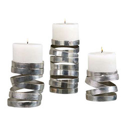 Uttermost Tamaki Silver Candleholders, S/3 - Metallic silver. Distressed white candles included. Abstract in design, these candleholders feature a metallic silver finish. Distressed white candles included. Sizes: sm-5x4x5, med-5x6x5, lg-5x8x5.