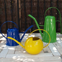 Metal Watering Cans in Garden Supplies - These watering cans are colorful and functional. They come in a mix of sizes and colors so they look great even when you're not using them.