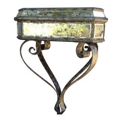Pre-owned Antiqued Glass and Iron Wall Shelf - Antiqued glass and distressed iron give this wall shelf a gorgeous balance of texture and reflection. This is the perfect accent for an entry, foyer, or hallway. The shelf is very heavy and substantial.