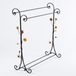 Flower Quilt Rack - Keep those quilts and blankets close at hand with a beautiful, floral quilt rack.  Delicate flowers and scroll accents ensure this rack will look great even when a quilt isn't hanging on it.