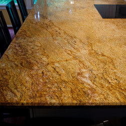Madura Gold Granite - Madura Gold Granite is a beautiful stone with gold, burgundy, red, orange, yellow, gold and black. It varies a good deal depending on what part of the quarry the blocks come from. It can be darker or lighter. It is quarried in India.