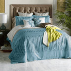 LAYLA Duvet Set - Summoning the serenity of sunlit seas, Layla Gulf Blue will quietly coax you into sweet dreams. Recalling the peaceful waters of a picturesque coastline, this duvet shines in a shade borrowed from the Persian Gulf. With a sumptuously soft structural surface made of enticing Tencel fabric, her tonal look is as naturally lustrous as it is wrinkle resistant. Two matching shams feature all-over pleating to tie back in with textured bands striping the duvet. Reverses to solid Gulf Blue cotton sateen.