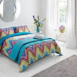 Beautiful Bedding - This bedding features a striking, oversized zig zag pattern in a vibrant mix of colours. The reverse of the duvet is turquoise and the duvet has a purple piping. Duvet is 100% cotton. Coordinating and matching items are available.