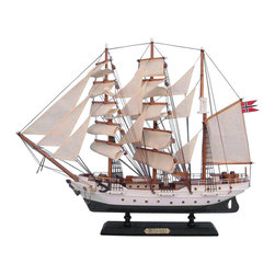Handcrafted Nautical Decor - Christian Radich 20'' - SOLD FULLY ASSEMBLED--Ready for Immediate Display - Not a Model Ship kit --These proud tall ships models of the Christian Radich are perfectly sized for any small mantle, shelf or desk. Inspired by the Norwegian merchant marine training cutter, star of both large and small screen as well as winner of tall ships races, the Christian Radich will add inspiring pride to a child's bedroom, a flair of nautical Decor to a den or living room, or an indomitable, winning spirit to any office or meeting room. --20'' Long x 5'' Wide x 17'' High (1:144 scale)----    Arrives fully      assembled with      all sails mounted--    Handcrafted wooden hull and masts--    High quality woods include cherry, birch, maple      and rosewood--    20 handsewn white cloth sails--    Metal nameplate on wooden base identifies the ship as the Christian Radich--