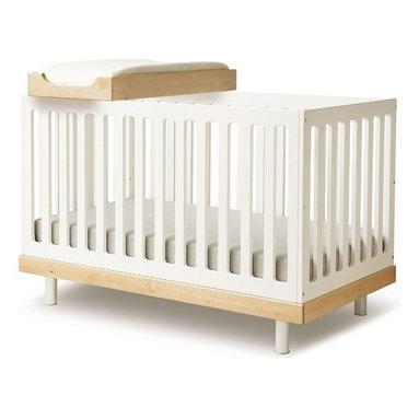 Oeuf Classic Crib - Classic Crib Collection by Oeuf. The Oeuf Classic Collection was created by parents who appreciate modern design. Like other European cribs, Oeuf uses fixed side rails to offer one of the sturdiest and safest cribs available. Classic Dresser, sleek matte, warm-white finish give the piece a sense of elegance. Four Drawers make for plenty of storage space. The Classic Hutch provides additional storage for those who already own the Classic Dresser. Holes for electrical wiring allow lamps and other electrical items to be placed on the shelves. The Changing Station is a great space-saving solution for small nurseries, eliminating the need for a separate changing table.