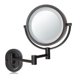 Jerdon HL65BZD Hard-Wired 8-Inch Two-Sided Swivel Halo Lighted Wall Mount Mirror - The Jerdon HL65BZD 8-Inch Two-Sided Swivel Halo Lighted Wall Mount Mirror is used in luxury hotels and day spas because of its convenience, sleek look, lighting and magnification. This fog free, two-sided circular mirror has an 8-inch diameter and features a smooth swivel design that provides 1x and 5x magnification options to make sure every detail of your hair and makeup are in place. The light design around the perimeter of the mirror and smooth rotation adjust to all angles for a dynamic point of view. This item can use the JPT25W replacement bulb (sold separately). An on/off rotary knob on the oval base will activate the lighting when you need it. The HL65BZD has a mounting bracket that measures 4-inches by 5-inches and extends 14-inches from the wall and can be easily moved around, while still being firm enough to hold for odd angles. This mirror has an attractive bronze finish that protects against moisture and condensation and is designed to be wall mounted. This item comes complete with mounting hardware and is designed as a hard-wire only application (does not have a power cord or plug). The Jerdon HL65BZD 8-Inch Two-Sided Swivel Halo Lighted Wall Mount Mirror comes with a 1-year limited warranty that protects against any defects due to faulty material or workmanship. The Jerdon Style company has earned a reputation for excellence in the beauty industry with its broad range of quality cosmetic mirrors (including vanity, lighted and wall mount mirrors), hair dryers and other styling appliances. Since 1977, the Jerdon brand has been a leading provider to the finest homes, hotels, resorts, cruise ships and spas worldwide. The company continues to build its position in the market by both improving its existing line with the latest technology, developing new products and expanding its offerings to meet the growing needs of its customers.