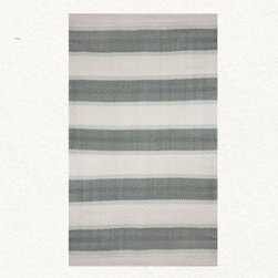 Green Stripe Rug - This rug is made of durable synthetics but has a light airy feel to it. I can see it lightening up a darker porch, bringing some color to an outdoor space.