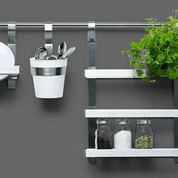 GRUNDTAL kitchen series - Probably the most well-know wall storage rail system is the one from Ikea. The pot rack shelves are pretty terrific too.