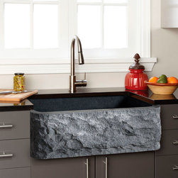 Polished Granite Farmhouse Sink - Chiseled Front - A stunning accent for a modern kitchen, this Granite Farmhouse Sink features a chiseled front that adds drama and earthy flair. Thanks to its natural stone composition, this sink is truly unique and a fantastic way to express your inimitable style. The interior well of this sink is smooth, for easy cleaning and excellent water drainage.