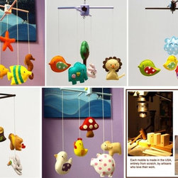 Animal Mobiles Unique Nursery Decor - Resisting the passe trend to go gaudy with baby decor, these quaint animal mobiles nod at the quaint and homemade world of magic. These elegant animal mobiles are as eye catching to adults as they are the infants cooing beneath them.
