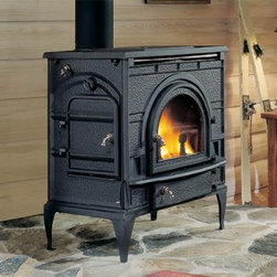 Majestic Dutchwest Catalytic Wood Stove - From your mountain cabin to a chic loft apartment the Majestic Dutchwest Catalytic Wood Stove is a safe and charming way to add efficient smoke-free heat to any space. The body of this classically inspired stove is crafted from wrought iron in a Federal style with a jet black finish and wide glass window that let's you enjoy the roaring fire. Logs can easily and safely be loaded from the front or side and they're held in place with traditionally styled irons. The glass air wash keeps the window clear and top or rear venting lets you decide how to get rid of smoke and flue gasses. You can use the raised stove top for warming and cooking and when it's time to clean the ash-lip on the front helps you keep ash away from your floors or carpet. A bottom-mounted heat shield is designed to accommodate your hearth pad while adjustable legs give you stability on almost any surface. An optional fan and thermostat with cord gives you more control over the level of heat you can create and where it goes. This stove is offered in multiple sizes so take the time to find out which one will produce the right amount of heat for your space. It is recommended that you use a professional installer to ensure the safety of the exhaust system. About MajesticFor over 50 years Majestic has crafted a name synonymous with quality wood and gas fireplaces for the home. With a vast array of products and styles including wood electric modern and traditional Majestic has something for every taste and decor. Majestic products are built to last offering a quality construction and innovative design structure that has made them a premier choice for homes across North America and beyond.