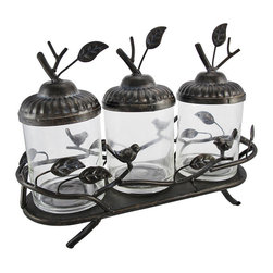 Decorative Birds and Leaves Glass Canister Set with Metal Display Tray - This set of nature themed canisters is a lovely accent to any table or shelf in your home. It features 3 glass canisters with lids that resemble acorns, complete with twig and leaf handles, on a decorative metal display tray with birds and leaves. Altogether, the piece measures 10 inches tall, 14 inches long, 5 1/2 inches wide, and each canister measures 7 3/4 inches tall (with the lid), 3 3/4 inches in diameter. Create a unique display by filling the canisters with different colors and textures, such as layers of colored sand, pebbles, potpourri, dried leaves or flowers, or candles. This piece makes a wonderful housewarming gift.