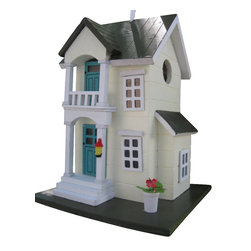 "Home Bazaar Inc. - Main Street Cottage Birdhouse - Yellow - This two story , pine shingled roofed house is ready to welcome nesting birds for the season . Details include a front portico, potted plant plus window and door trim. Our Main Street Cottage has all of the qualities  a birding enthusiast seeks including a back wall cleanout, drainage, ventilation,  unpainted interior and a 1 1/4"" side entry hole to invite nesting birds in and keep larger ones out. The finish is an outdoor, water-based, non-toxic paint. Likely inhabitants may include chickadees, nuthatches, wrens and titmice. Loop the heavy duty nylon cord to the desired height and put this house out on your own avian Main Street!"