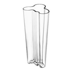 Finlandia Vase by Alvar Aalto - Any design fan will be thrilled to receive this iconic vase by Alvar Aalto (in fact, it's my go-to wedding gift for all of my architecture school friends). Elegant and sculptural, it will inspire your giftee to keep fresh flowers in it every day.