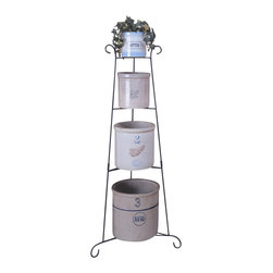J&J Wire - 45 in. Freestanding Plant Stand - Crocks are not included. Unique design. Durable construction. Welded fabrication. Free-standing scrolled design. Four tiers to hold crocks or plants. Arrives in two pieces which easily slide together. Made from durable wrought iron. Rich black powder coated finish. Made in USA. Assembly required. 19 in. Dia. x 45 in. H (6 lbs.)Display your favorite collections of treasured crocks, plants or pots and pans. Sturdy black wrought iron cured under heat to produce a hard durable rich black finish.