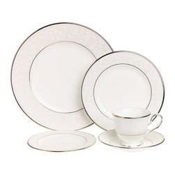 Lenox - Lenox Opal Innocence 20-Piece Set - 6141006 - Shop for Sets from Hayneedle.com! There's a reason the pattern adorning the Lenox Opal Innocence 20-Piece Set is the most popular in America. It's classically beautiful. Each piece of bone china is delicately decorated with a white-on-white vine design peppered with enameled dots and banded in platinum. This set is dishwasher-safe.Set Includes:4 dinner plates4 salad plates4 bread and butter plates4 saucers4 teacupsAbout LenoxThe Lenox Corporation is an industry leader in premium tabletops giftware and collectibles. The company markets its products under the Lenox Dansk and Gorham brands propelled by a shared commitment to quality and design that makes the brands among the best known and respected in the industry. Collectively the three brands share 340 years of tabletop and giftware expertise.
