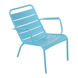 "Fermob - Luxembourg Stacking Low Armchair Set of 2 by Fermob - For stylish, laidback lounging, keep it low. The Fermob Luxembourg Stacking Low Armchair Set of 2 has reclined profiles and curved slats designed for maximum comfort and relaxation. It is made entirely out of aluminum and is coated in one of 24 durable powder coat colors. This set is stackable for quick and easy storage. Based in Thoissey, France, Fermob has been creating fine outdoor furniture since 1953. Their current line of colorful and comfortable aluminum and steel furniture promotes the ""Outdoor Lounge"" way of life. It encourages outdoor rest and relaxation while caring for, protecting and improving the environment it inhabits. All Fermob outdoor furniture is made in France out of recyclable materials."