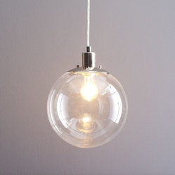 Globe Pendant - This globe pendant is beautiful in its simplicity and rather easy on the pocketbook. The glass material and spherical shape will never look dated, and it works well in every room of the house.