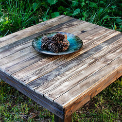 The Farmhouse Reclaimed Pallet Wood Coffee Table - The Farmhouse is a rustic and beautiful table with rich tones of browns and greys highlighting all of the natural scruffs and scrapes of the wood. The top of the table has a clear coat of water-based poly which brings out the character - and keeps it spill resistant! The frame of the table is stained in American Walnut.