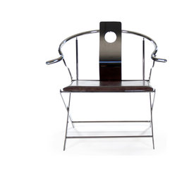 Zentique - Pedro Chair - The Pedro Chair features a rounded back metal frame with a leather seat.