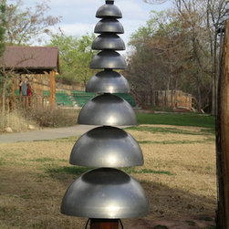 Pagoda Bells - Reminiscent of the architecture of the Orient, the Pagoda is a vertical array of bells that provide lush tones of long duration. Durable and completely maintenance-free, the Pagoda Bells are a calming addition to any outdoor setting. As a park or ganden ornament, or as an engaging piece of interactive urban art, this instrument rings with blended tones, focusing attention on any outdoor setting.