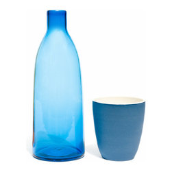 Contemporary Glass Water Carafe Set with Ceramic Goblet, Blue - A colorful water carafe set with a goblet that matches the color of the carafe.  Carafe handcrafted with blown glass and goblet made from ceramic, makes a perfect addition to any modern or contemporary serverware set.  Can be used as modern water carafe, contemporary water carafe, glass water carafe, glassware, decorative water carafe, water container, water jar, and water bottle.  Comes in Olive Green, Saffron, Aubergine, Blue, and Gray colors.
