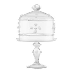 Juliska - Juliska Isabella Medium Cake Dome Pedestal Set Clear - Juliska Isabella Medium Cake Dome-Ped. Set Clear. Juliska glass is mouth-blown by artisans in the hills outside Prague. The techniques they use have been passed down through generations. To watch these skilled glassmakers work is breathtaking. Being handmade, no two pieces of Juliska are identical. Each has its own exquisite, individual character. Uniqueness is valued and guaranteed. Every piece of Juliska glass is individually signed as a hallmark of its origin and authenticity. With such heritage, attention to detail and beauty, it is no wonder Juliska glass is extraordinary.