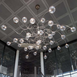 Harco Loor - Harco Loor   Big Bubbles HL 35 Chandelier - Made in The Netherlands by Harco Loor Design.The Big Bubbles HL 35 Chandelier brings a touch of whimsy to your space with delicate glass bubbles spiraling around on stainless steel stems. With adjustable arms that can be stretched in every direction you can tweak your light to just the way you like it. This grand chandelier is perfect for adding that wow factor to your space whether it's over your dining room table or hanging in your entry way. Big Bubbles provides ambient lighting. Made from stainless steel metal and glass.