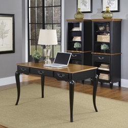 Home Styles French Countryside Oak and Rubbed Black Executive Desk - The Home Styles French Countryside Oak and Rubbed Black Executive Desk offers traditional style for today's executives, including period French country details such as graceful cabriole legs and decorative, brass-finished drop pull hardware on its drawer fronts. Constructed from genuine poplar solids and durable engineered wood, this beautiful desk features hand-distressed oak veneers, with an oak-finished desktop providing eye-catching contrast with the heavily rubbed black frame finish. The optional matching hutch includes three storage drawers and a base cutout for computer cord access.About Home Styles?Home Styles is a manufacturer and distributor of RTA (ready to assemble) furniture perfectly suited to today's lifestyles. Blending attractive design with modern functionality, their furniture collections span many styles from timeless traditional to cutting-edge contemporary. The great difference between Home Styles and many other RTA furniture manufacturers is that Home Styles pieces are crafted from solid wood, and feature quality hardware that will stand up to years of use. When shopping for convenient, durable items for the home, look to Home Styles. You'll appreciate the value.