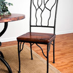 Mathews & Company - Camelot Dining Side Chair - The Camelot chair with seat makes ordinary chairs look just that - ordinary! This beautifully hand wrought iron chair is contrasted with a variety of different seats. Choose between four different options of upholstery for the seat to match the style and color of the chosen room. Further make this chair your own by selecting one of several different iron finishes. Simple yet artistic, this chair is creatively crafted with iron veins streaming up its back. Pictured in Old World Pine upholstery and Black finish.