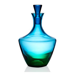 Vague Glass Decanter - An enchanting blend of blue and green glass, the Vague Glass Decanter inspires daydreams of cool summer evenings when daytime and twilight mingle on the horizon in a captivating wash of color. A perfect vessel for enjoying liquid refreshment at the end of the day or for serving guests their preferred libation.