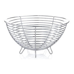 Stainless Wire Bowl - Created exclusively for us by industrial design maven Carter McGuyer, this contemporary open wire basket with gleaming electro-polished mirror finish features integrated feet to elevate your centerpiece display of fruit, vegetables or ornamental objects. Thin-gauge wire is soldered to four structural ribs for durability. This special piece is destined to make a great wedding or housewarming gift.