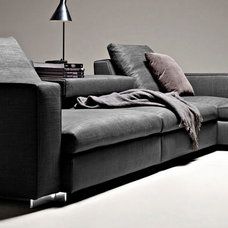 Modern Sofas by Urbanspace Interiors