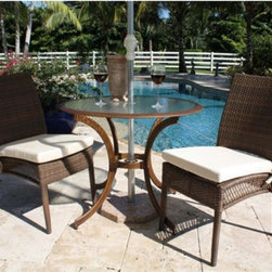 Hospitality Rattan - Hospitality Rattan Grenada 3 Piece 36 in. Patio Dining Bistro Set - Viro Fiber A - Shop for Tables and Chairs Sets from Hayneedle.com! Your favorite cafe isn't far - in fact with the Hospitality Rattan Grenada 3 Piece 36 in. Patio Dining Bistro Set - Viro Fiber Antique Brown it's just outside the back door. The Grenada Collection has a modern tropical feel that offers a clean look for any patio area - not to mention the convenience of all-weather wicker. This set's two armless chairs are each supported by an aluminum frame wrapped in high quality antique brown Viro fiber. High backs offer supreme comfort and decorative open weaving along the sides of each seat is light and airy. The rust-resistant dark bronze aluminum table boasts dramatically curved legs an artful center support and a clear tempered glass top.DimensionsChairs: 24L x 24W x 37H inchesTable: 36 diam. x 29H inchesAbout Hospitality Rattan Hospitality Rattan has been a leading manufacturer and distributor of contract quality rattan wicker and bamboo furnishings since 2000. The company's product lines have become dominant in the Casual Rattan Wicker and Outdoor Markets because of their quality construction variety and attractive design. Designed for buyers who appreciate upscale furniture with a tropical feel Hospitality Rattan offers a range of indoor and outdoor collections featuring all-aluminum frames woven with Viro or Rehau synthetic wicker fiber that will not fade or crack when subjected to the elements. Hospitality Rattan furniture is manufactured to hospitality specifications and quality standards which exceed the standards for residential use. Hospitality Rattan's Environmental Commitment Hospitality Rattan is continually looking for ways to limit their impact on the environment and is always trying to use the most environmentally friendly manufacturing techniques and materials possible. The company manufactures the highest quality furniture following sound and responsible e